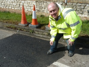 Inspecting the quality of the new Pot Hole repairs
